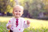 Little girl in a field — Stock Photo
