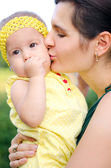 Mother kissing her daughter — Stock Photo