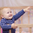 Little girl in a crib — Stock Photo