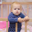 Stock Photo: Discontented baby girl