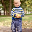 Shy baby with apple — Stockfoto #32551737