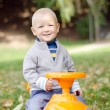 Kid on toy car — Stock Photo