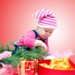Baby with Christmas gifts — Stockfoto