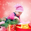 Baby with Christmas gifts — Foto Stock