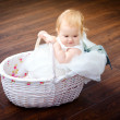 Girl in the basket — Stock Photo