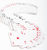 "Playing cards. All the cards form an ""S"" on a white background. — Stock Photo"