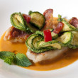 Постер, плакат: Crispy pan fried mullet filet on tomato gaspacho served with a mint flavored zucchini ratatouille