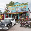 Classic Car Scene - Seligman, Route 66, Arizona. Famous as the origin of historic Route 66 and inspiration for the town of Radiator Springs in the Pixar movie Cars. — Stock Photo #49983619