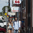 Many people during their holiday like to follow the route 66 from California to Arizona. We can see same tourist walking and visiting shops in the streets of the small city of williams on the 66 route — Stock Photo #49983669