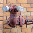 Old fire hydrant points — Stock Photo