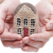 Knitted house in hand — Stock Photo