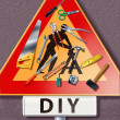 Group of tools spread on a traffic sign with DIY man icon — Stock Photo