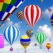 Hot-air balloons in the sky, with gifts in place of the basket - Stock Photo