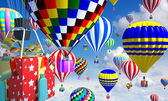 Hot-air balloons in the sky, with gifts in place of the basket — Stock Photo