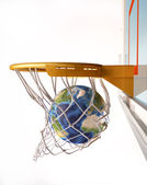 Earth globe centering the basket, close up view. — Stock Photo