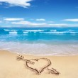 Heart with arrow, as love sign, drawn on the beach shore, with t — Stock Photo #25693471