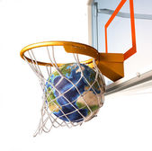 Planet earth falling into the basketball basket by a perfect sho — Stock Photo