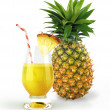 Pineapple and drink glass, with a fruit chunk and straw. — Stock Photo