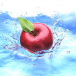 Red apple with leaf, splashing into water. bird eye view. — Stock Photo #25722585