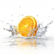 Orange slice falling and splashing into clear water. — Stock Photo #25724621