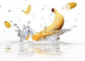 Banana splashing into clear water. — Stock Photo