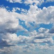 Blue sky with many cumulus fluffy white clouds. Very wide format — Stock Photo #25816789