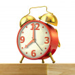 Classic alarm clock with red body and golden bells — Stock Photo #25827345