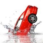 Red generic sedan car, falling into water splashing. — Stock Photo #25827439