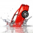 Stock Photo: Red generic sedcar, falling into water splashing.