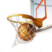 Basket ball centering the basket, close up view. — Stock Photo
