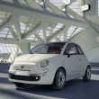 Fiat 500 city car, alone in the middle of a huge modern building — Stock Photo #25830019