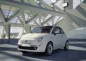 Fiat 500 city car, alone in the middle of a huge modern building — Stock Photo