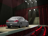 Sedan car on a fashion runway, in the spotlght. — Stock Photo