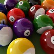 Stock Photo: Group of billiard balls with numbers, on green carpet table. Clo