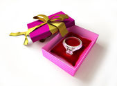 Gift package, with ribboned open cup, with ring and diamond on a — Stock Photo