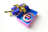 Opened gift box with golden ribbon, with the euro symbol inside — Stock Photo