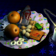 Decorated Christmass dish with fruits and sweets, besides a candle — Stock Photo