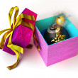 Opened gift box with bomb inside, on white surface. — Foto Stock