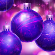Christmass purple abstract background with big decorated blue balls in foreground. — Stock Photo