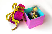 Opened gift box with bomb inside, on white surface. — Stock Photo