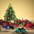 Stock Photo: Christmass tree with several gifts
