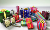 Group of gifts spread on a white surface, with one of them empha — Stock Photo