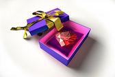 Shiny heart into a gift box. — Stock Photo