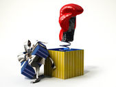 Boxing glove coming out from a gift box — Stock Photo