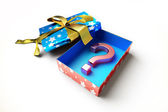 Present box open revealing as content, a big question mark symbo — Photo