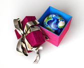 Gift package, with ribboned open cup, with planet earth inside — Stock Photo