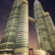 Petronas towers, night time, dramatic view from below. — Stock Photo #26103621