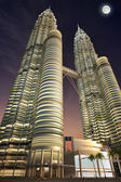 Petronas towers, night time, dramatic view from below. — Stock Photo