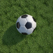 Soccer, football  ball close up on grass lawn. Top view. — Stock Photo
