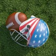 American football helmet decorated as US flag and ball, on the g — Stock Photo #29921277